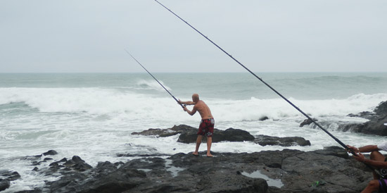 Fisherman in Port St Johns casting his line